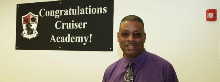 Principal William C. Young, Jr. with banner