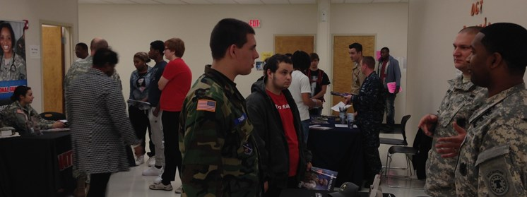 Students talking to military representatives