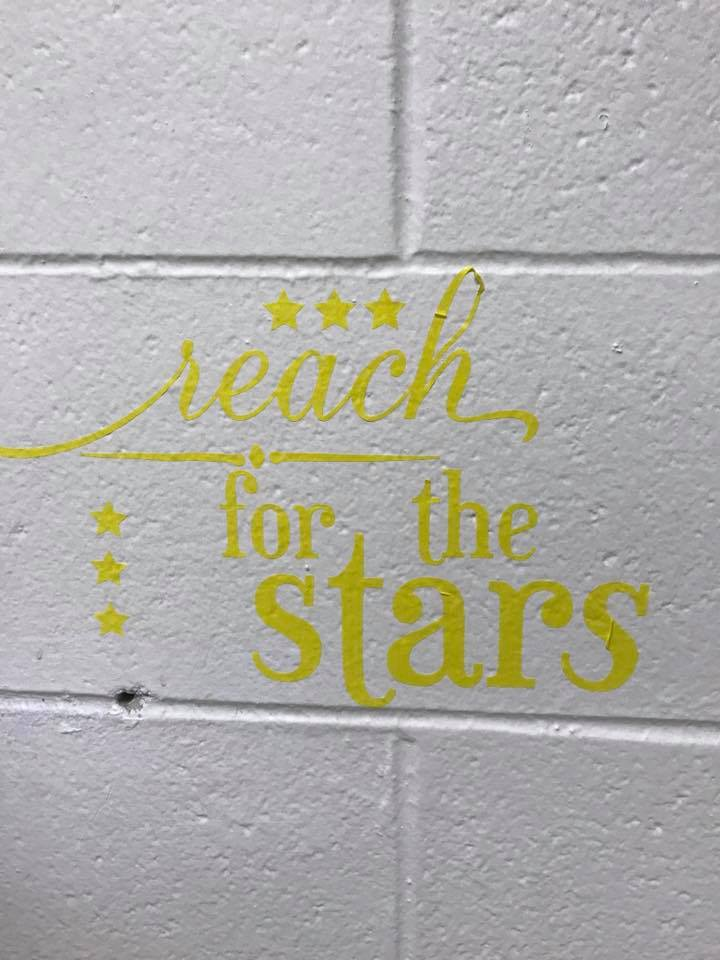 wall sticker that says reach for the stars