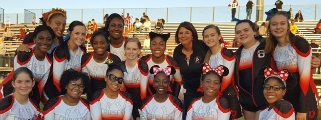 Superintendent Garilee Ogden with GMHS Cheerleaders Before Home Football Game