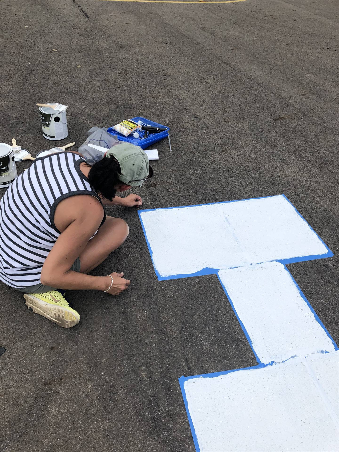 Teacher painting hopscotch