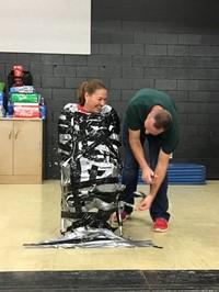 Mr. Stapleton helped Mrs. Lewellen escape at the end!