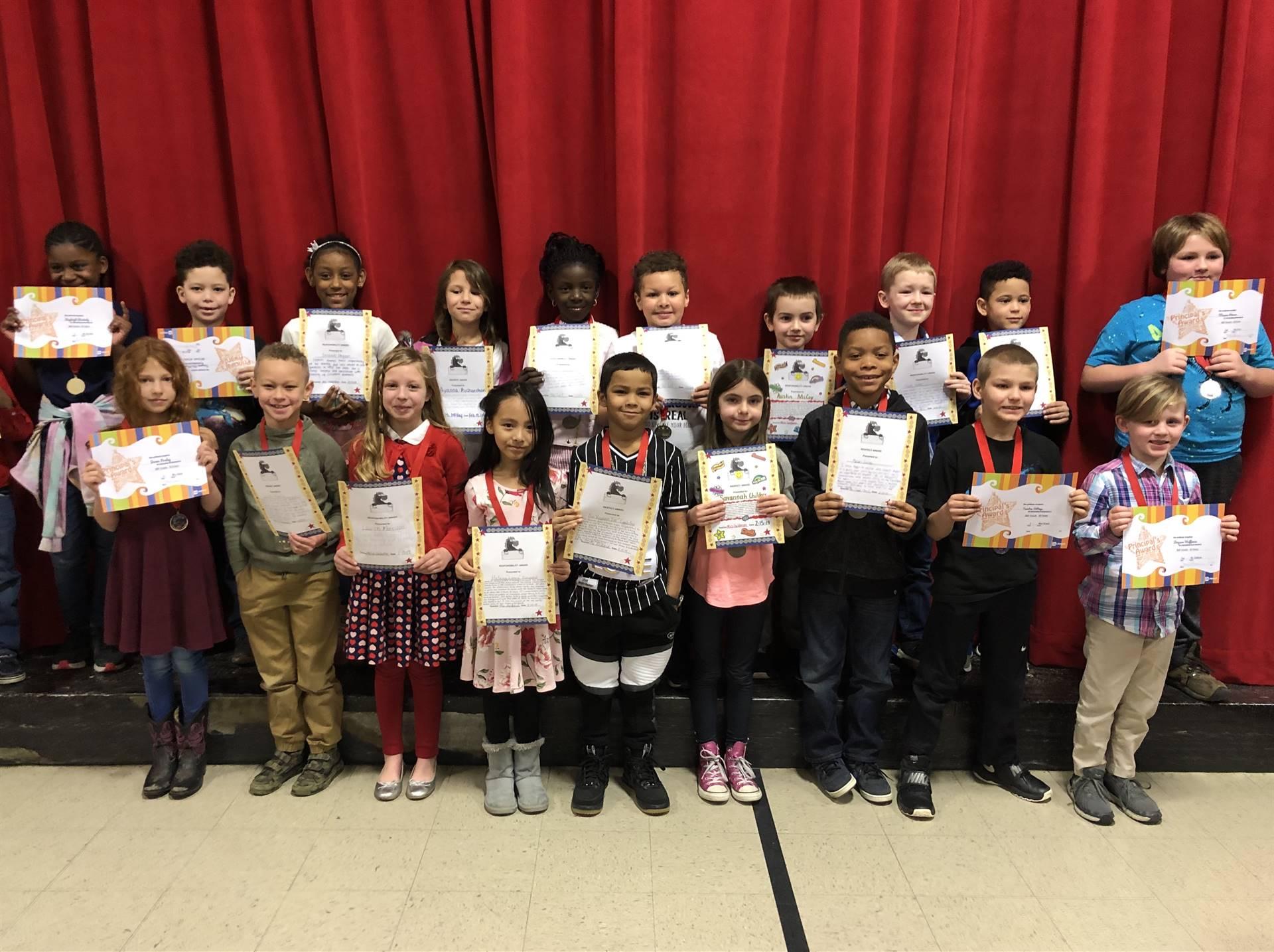students holding a reward