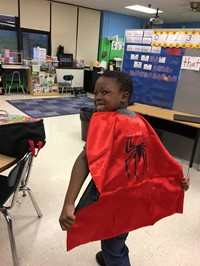 A student shows off an award he earned!