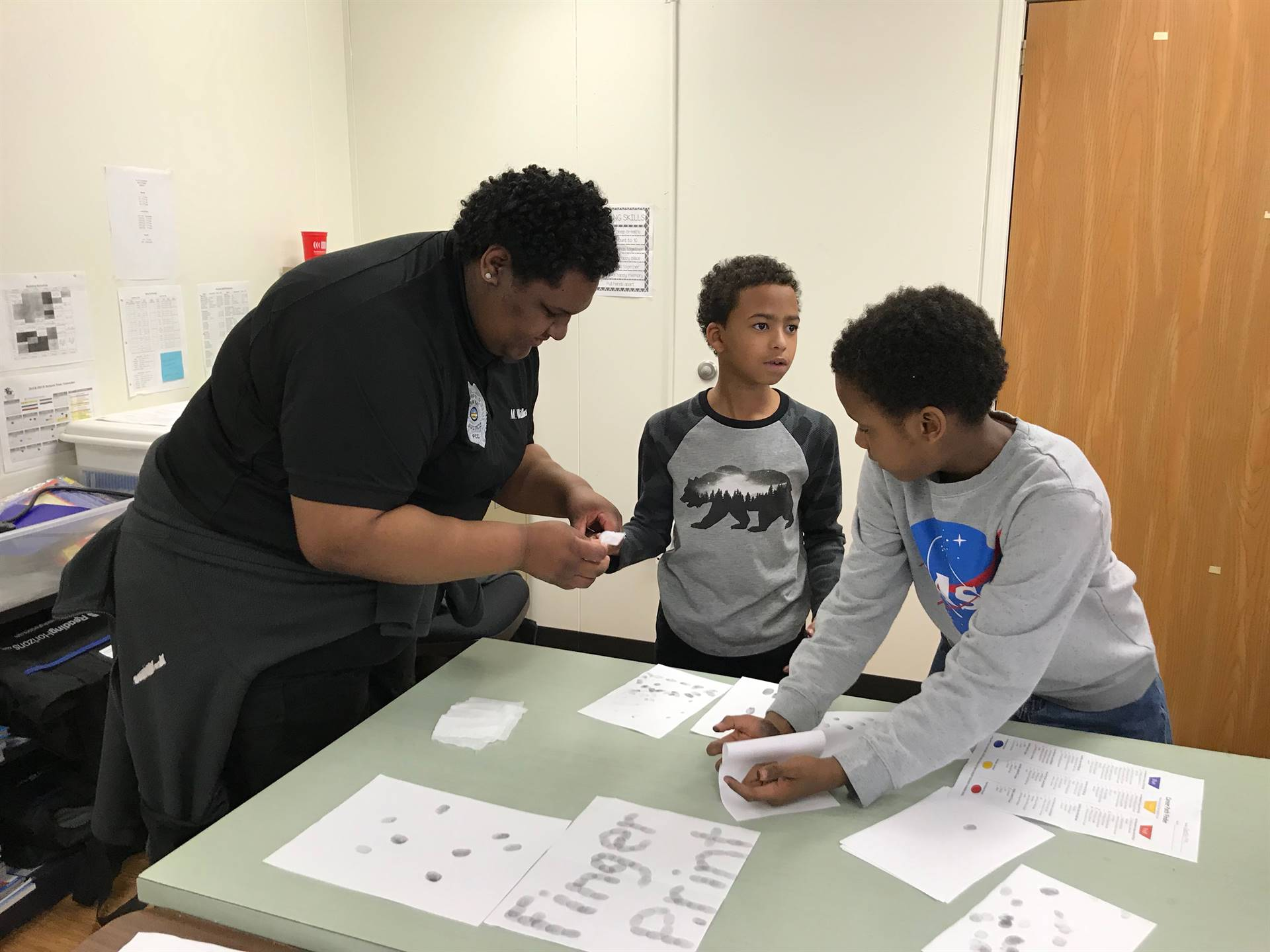 students being fingerprinted