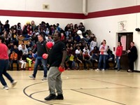 staff member playing dodgeball