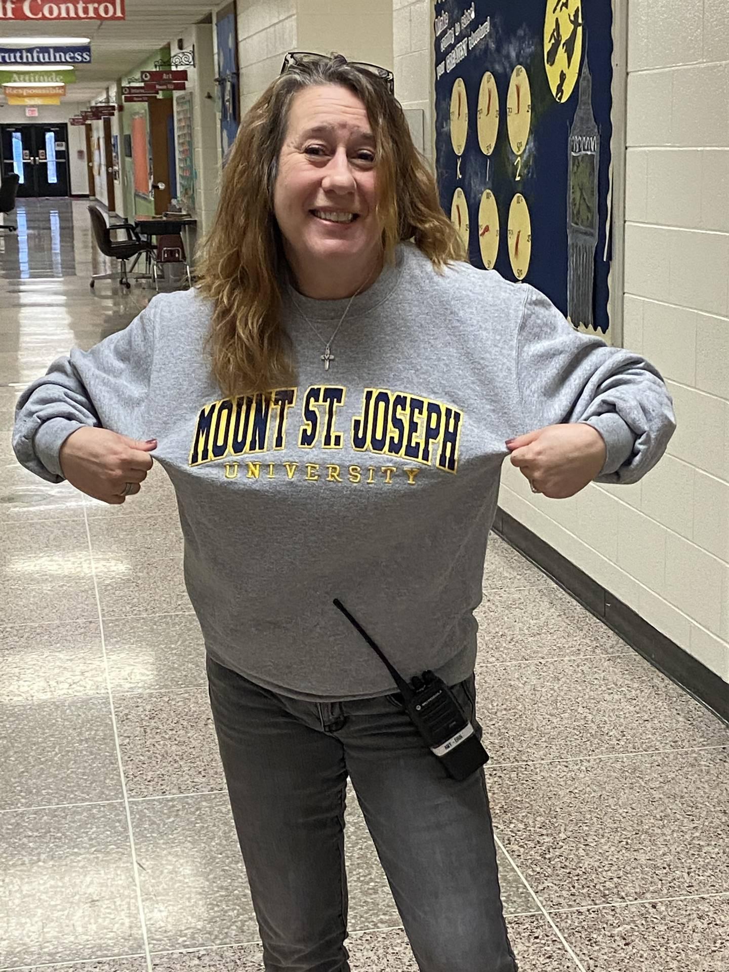 A teacher representing her university