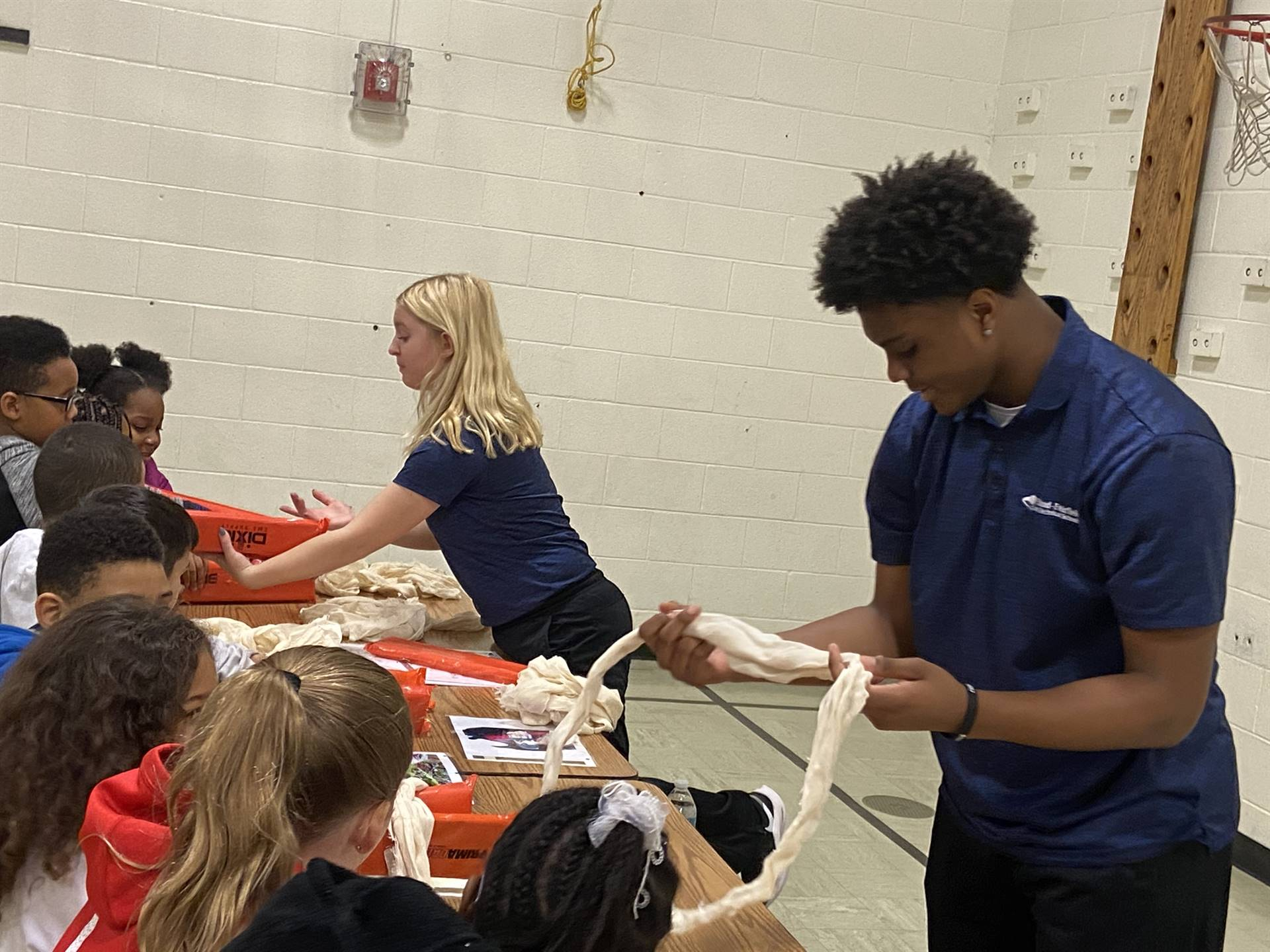Students learning about first aid