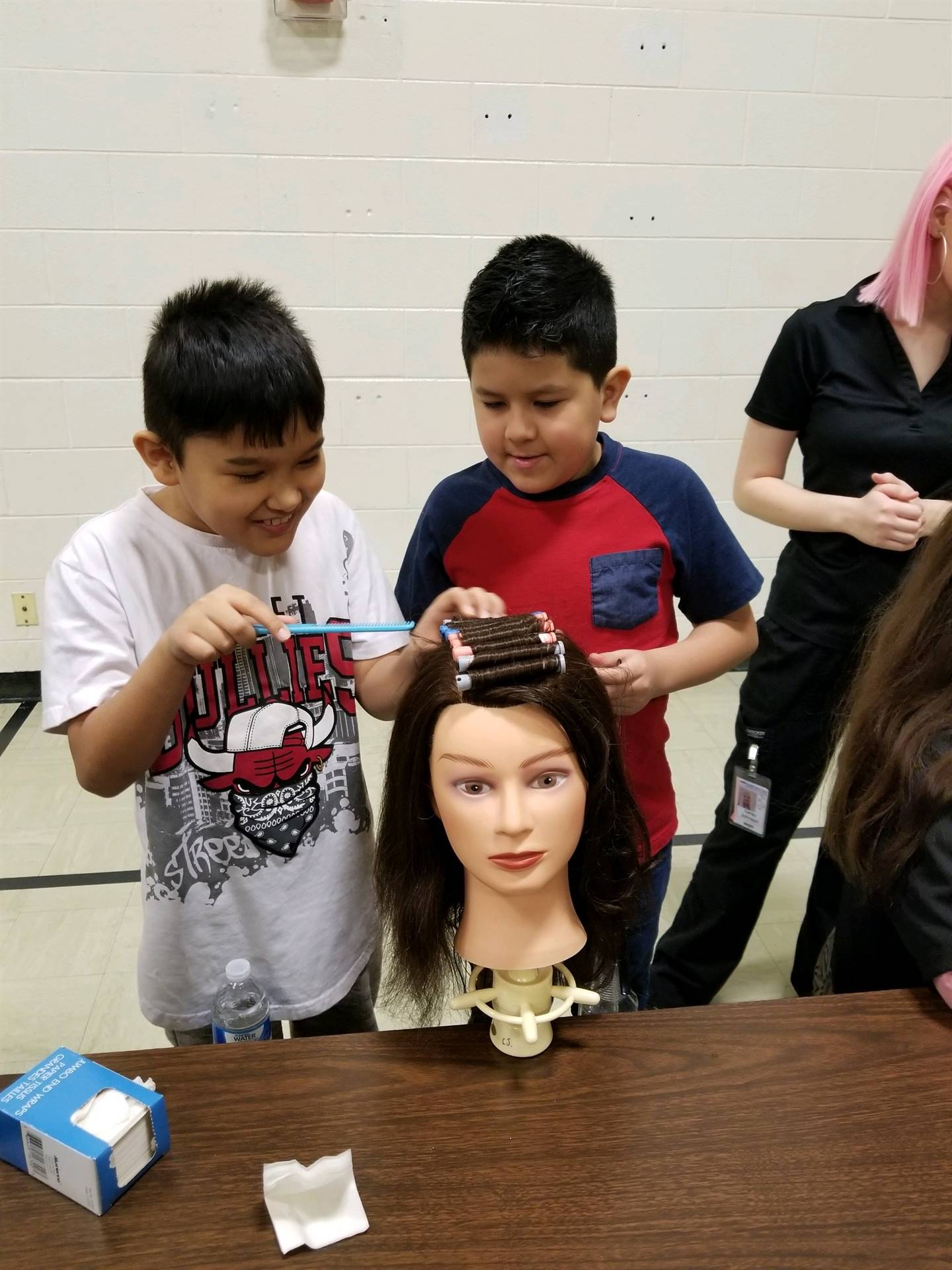 Students practicing hair styles