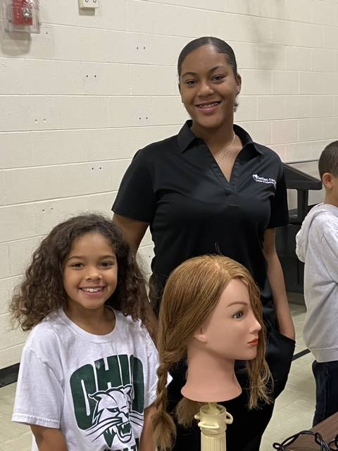 Students at the Hair station