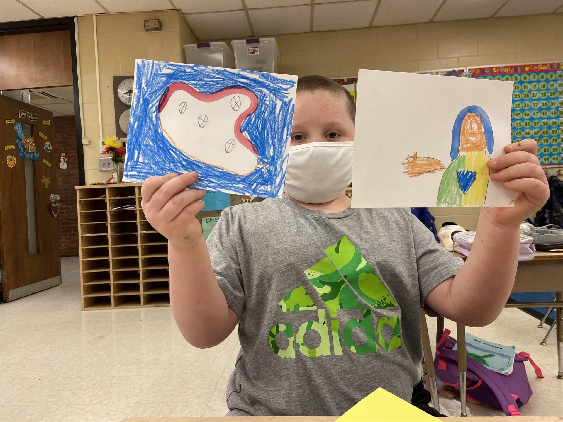 Student holding artwork