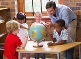 teacher showing location on globe