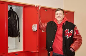 "Boy with ""GM"" Jacket"